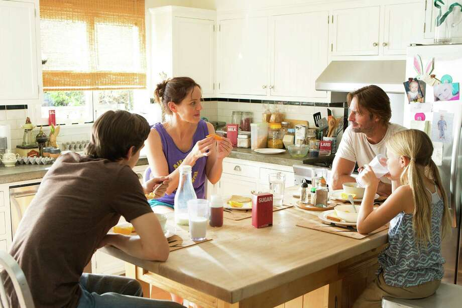 Sarah Wayne Callies as Katie Bowman, Josh Holloway as Will Bowman, Isabella Crovetti-Camp as Grace Bowman. Photo: USA Network / Isabella Vosmikova / USA Network / 2014 USA Network Media, LLC