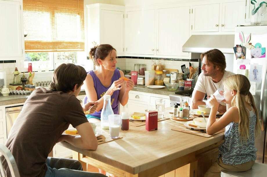 Sarah Wayne Callies as Katie Bowman, Josh Holloway as Will Bowman, Isabella Crovetti-Camp as Grace Bowman. Photo: USA Network / Isabella Vosmikova / USA Network / 2014 USA Network Media, LLC