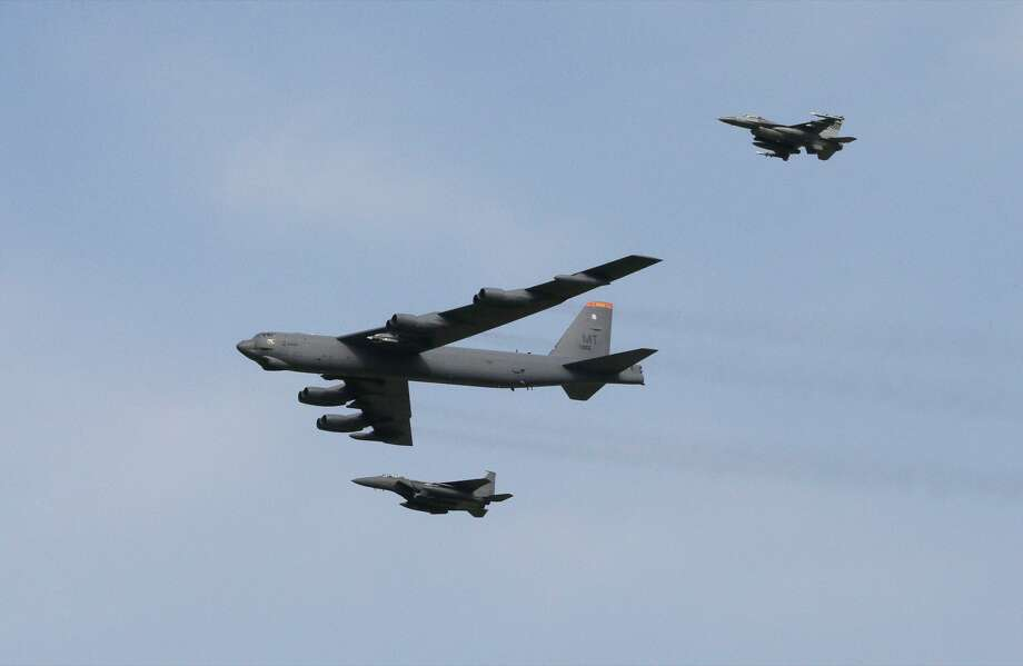 A U.S. Air Force B-52 bomber flies over Osan Air Base in Pyeongtaek, South Korea, Sunday, Jan. 10, 2016. The powerful U.S. B-52 bomber flew low over South Korea on Sunday, a clear show of force from the United States as a Cold War-style standoff deepened between its ally Seoul and North Korea following Pyongyang's fourth nuclear test. (AP Photo/Ahn Young-joon) Photo: Ahn Young-joon, Associated Press / AP