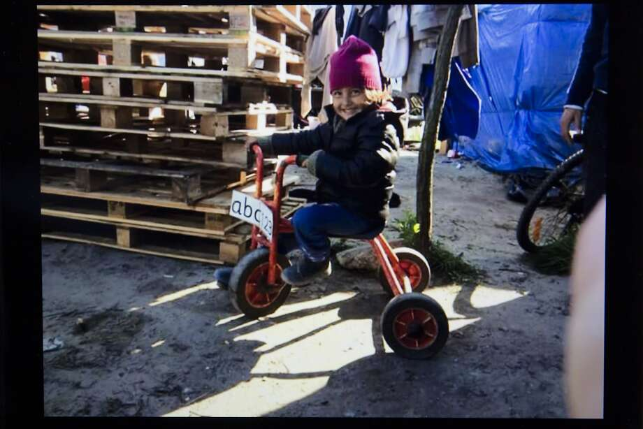 """Bru,"" 4, is shown riding a tricycle in a photo posted on facebook page of Rob Lawrie, who faces imprisonment. Photo: Jon Super, Associated Press"