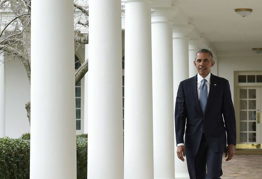 President Obama walks through the Colonnade at the White House before delivering his eighth and final State of the Union address. Photo: Mandel Ngan, AFP / Getty Images