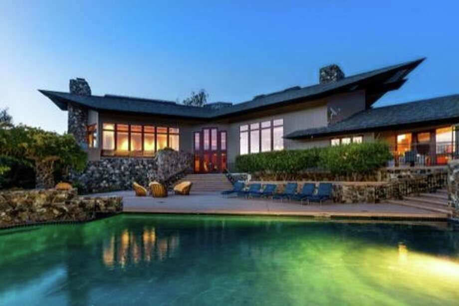 A Woodside estate at 6 Quail Meadows Dr. was first listed at $20 million in 2014 and sold for $8.775 million in June 2016. Photo: Pacific Union, Scott DuBose