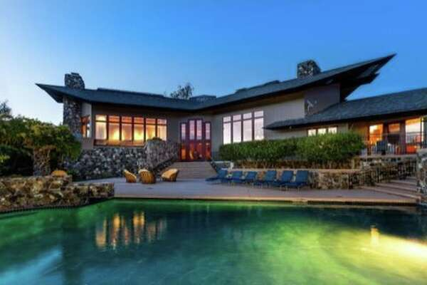 A Woodside estate at 6 Quail Meadows Dr. was first listed at $20 million in 2014 and is now on the market for $10 million.