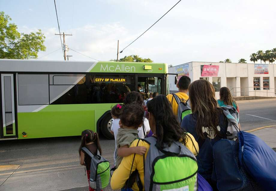 Immigrant families who had entered the U.S. illegally board a bus in April in McAllen, Texas. The number of Central American families arriving this fall more than doubled from 2014. Photo: Seth Robbins, Associated Press