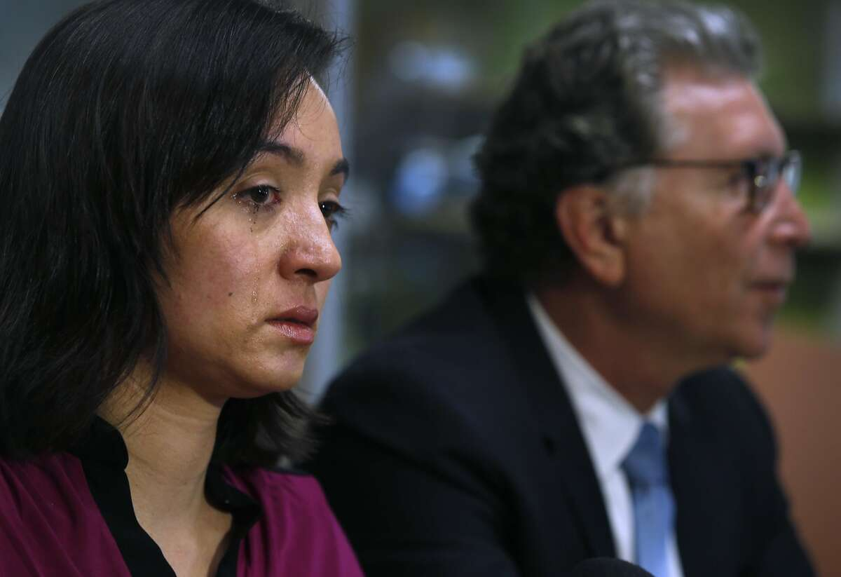 Heather Marlowe appears at a news conference with her attorney Irwin Zalkin to announce a civil lawsuit against the San Francisco Police Department in San Francisco, Calif. on Tuesday, Jan. 12, 2016. Marlowe claims the police department failed to adequately investigate her report of a rape in 2010 and improperly handled her rape kit examination.