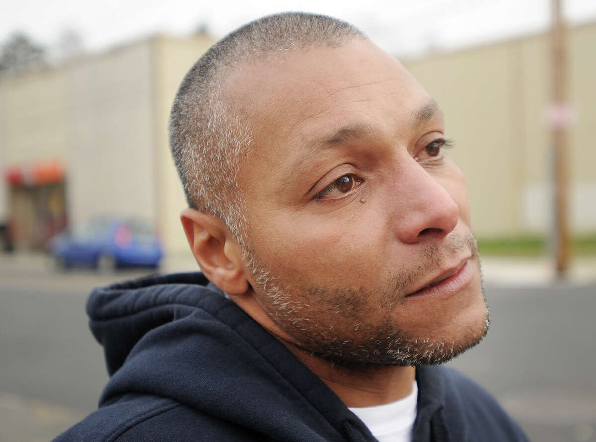 Angel Martinez, of Bridgeport, brother of Carmen Martinez, who was struck and killed by a pickup truck while crossing John Street on Monday, talks about his sister near the location of the accident in Bridgeport, Conn. on Tuesday, January 12, 2016.