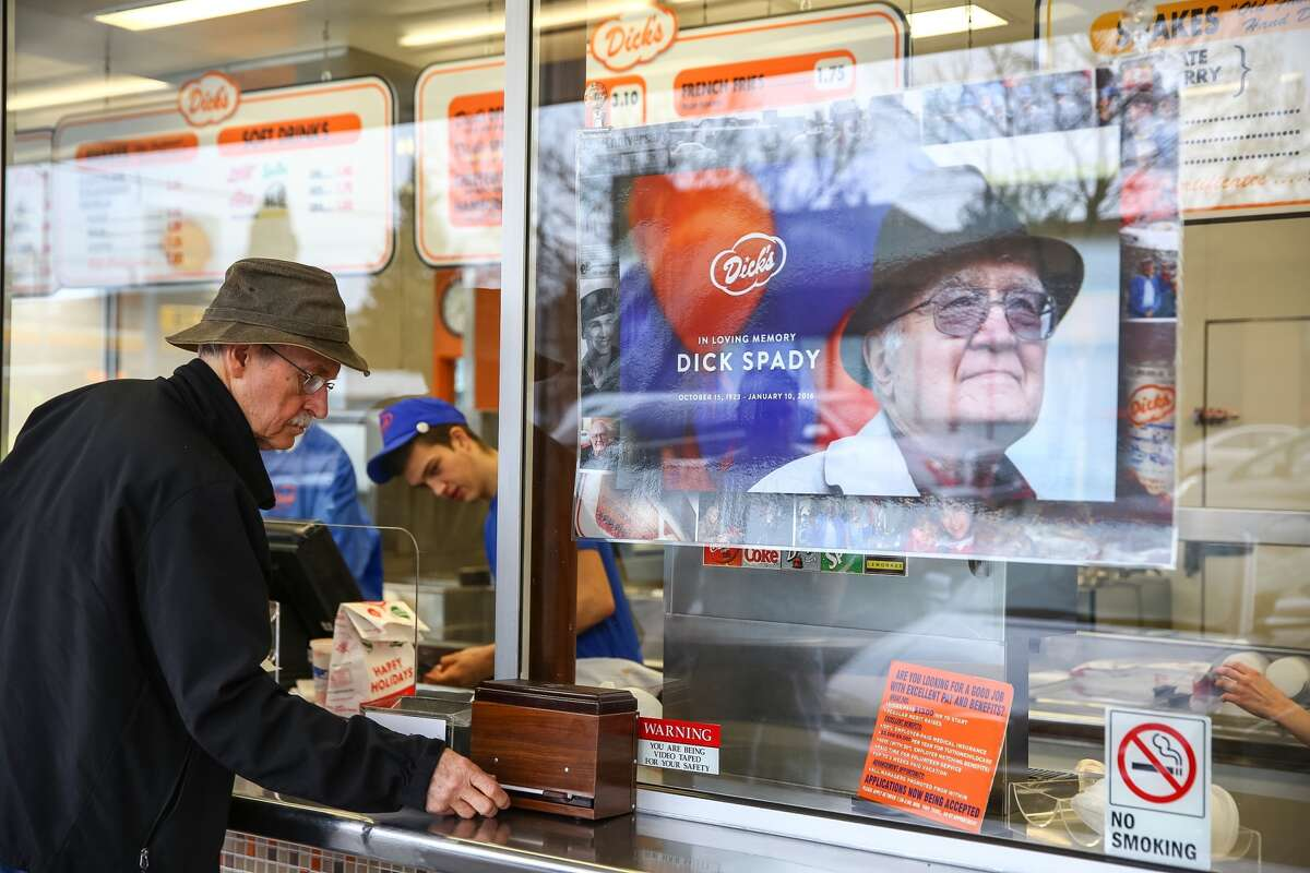 A sign memorizing Dick's Drive-In co-founder Dick Spady hangs in the window the burger chain's flagship restaurant in Seattle's Wallingford neighborhood. Spady's death, which occurred Sunday, Jan. 10, 2016, was made public Tuesday. He was 92.