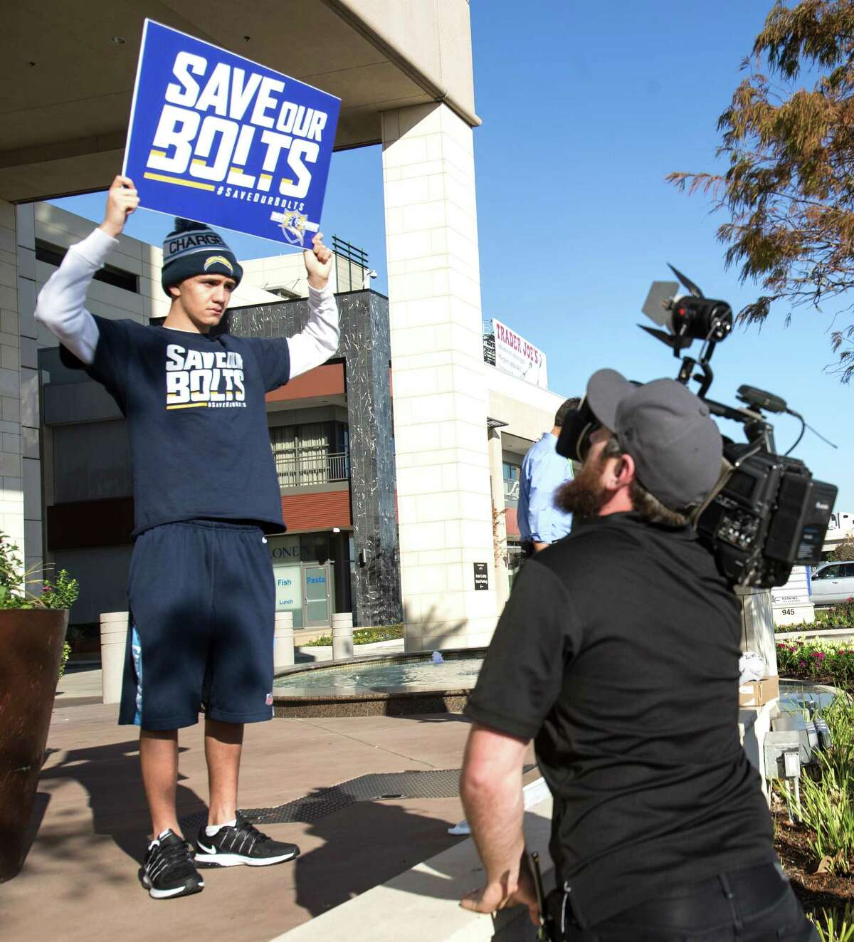 San Diego Chargers fan Richard Farley stands outside the Westin Houston Memorial City hotel during the NFL owners meetings on Tuesday, Jan. 12, 2016, in Houston. Farley is hoping to keep the Chargers in San Diego.
