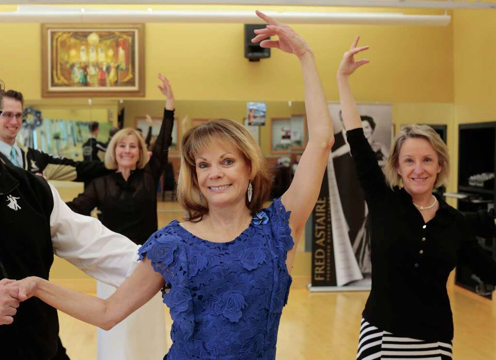 Barb Stawick, Patty Levison and Michelle Allen (from left) work on their steps at the Fred Astaire Dance Studio. The women, who are all widows, have found friendship and support after the loss of their spouses through ballroom dance. From left, Barb Stawick, Patty Levison, and Michelle Allen pose for a photo at the Fred Astaire Dance Studio on Dec. 29, 2015 in Bloomfield Hills, Mich. The women who are all widows have found friendship and support after the loss of their spouses through ballroom dance. (Ryan Garza/Detroit Free Press/TNS) Photo: Ryan Garza/Detroit Free Press, MBR / Ryan Garza/Detroit Free Press / Detroit Free Press