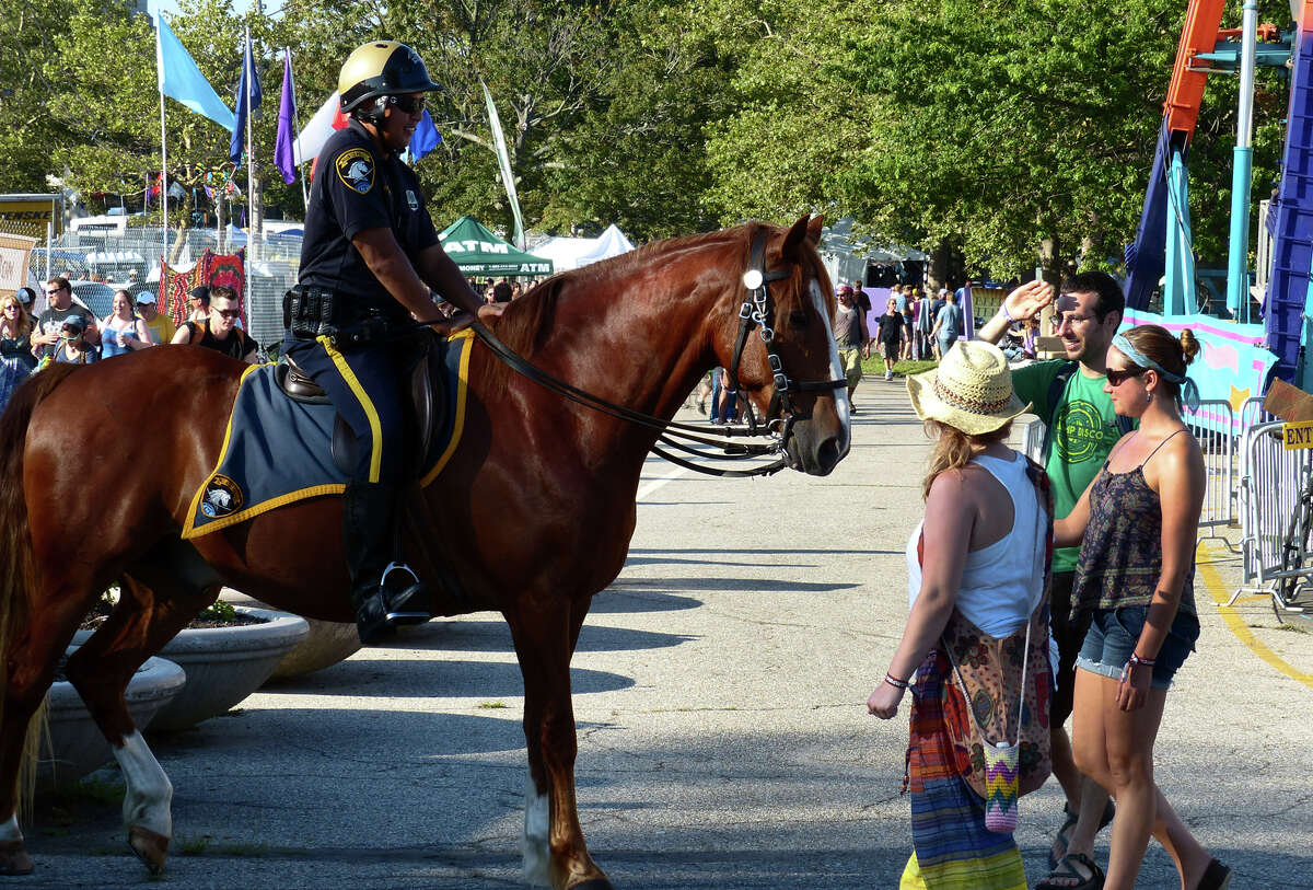 A Bridgeport mounted police officer pauses at the Gathering of the Vibes music festival at Seaside Park in 2013 City officials say Vibes organizers owe $750,000 for police overtime.
