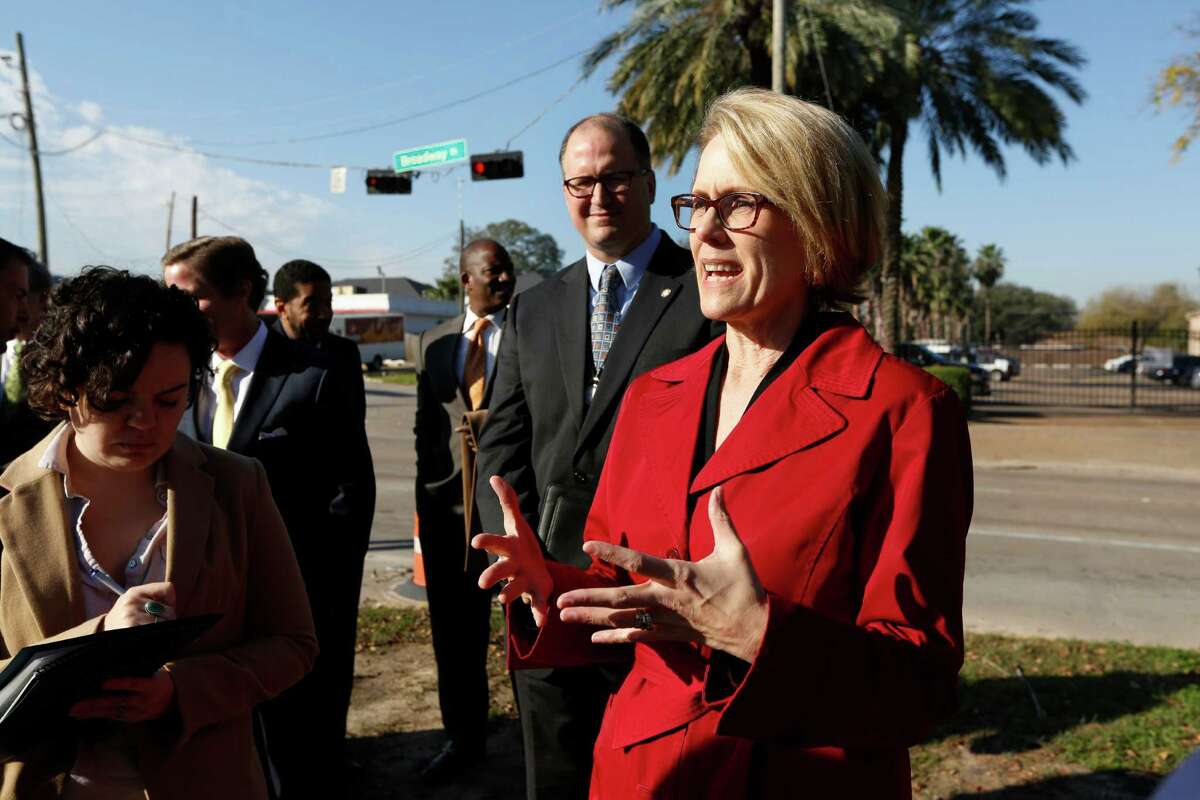 """Scenic Houston President Anne Culver talks the media bear the intersection at Broadway St & Morley St, Tuesday, Jan. 12, 2016, in Houston is a work in progress. Scenic Houston announced their vision to revitalize Broadway Street, the 2-mile corridor that connects Houston's Hobby Airport to Interstate 45, with construction to begin early 2016. This major thoroughfare is currently undergoing infrastructure updates by the City of Houston and Texas Department of Transportation. The Scenic Houston project will fund landscaping, infrastructure enhancements and other amenities desperately needed to dramatically transform its appearance, creating a more visually appealing """"welcome to Houston"""" for visitors, and act as a catalyst for future development along Broadway. ( Steve Gonzales / Houston Chronicle )"""