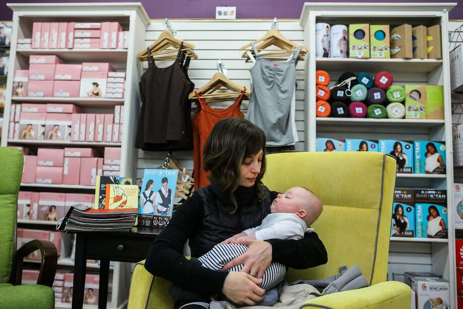 Rose Collins and her 4-month-old son, Jack Collins, take a break from shopping at Natural Resources. Collins would have welcomed paid maternity leave, but is moving from the city for financial reasons. Photo: Gabrielle Lurie, Special To The Chronicle