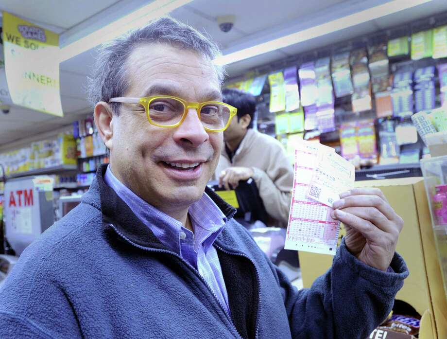 Joe Munoz of Greenwich displays the Powerball lottery tickets he purchased at the Stateline Smoke shop in the Byram section of Greenwich, Conn., Tuesday, Jan. 12, 2016. Photo: Bob Luckey Jr. / Hearst Connecticut Media / Greenwich Time