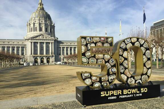 A Super Bowl 50 sign sits in front of San Francisco City Hall, where advocates kicked off a human trafficking awareness campaign on Tuesday morning.