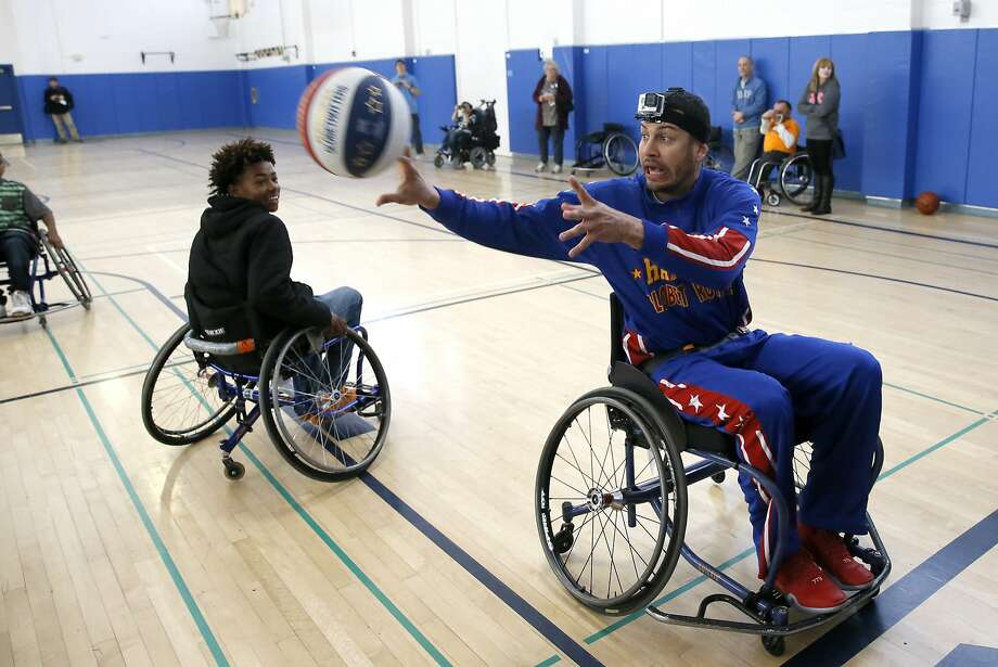 "Andre Cox, (left) covers Orlando ""El Gato"" Melendez of the Harlem Globetrotters as they participate in a disability awareness event by playing in a wheelchair basketball game with students at Martin Luther King Jr. Middle School in Berkeley, Calif. on Tues. January 12, 2016. The Globetrotters  are town this week for games around the Bay Area. Photo: Michael Macor, The Chronicle"