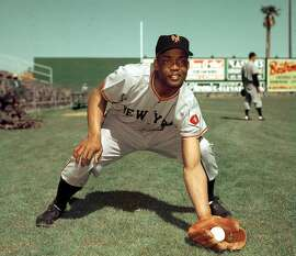 FILE- In this 1952, file photo, San Francisco Giants infielder Monte Irvin poses during spring training. Irvin, a Hall of Fame power-hitting outfielder who starred for the New York Giants in the 1950s in a career abbreviated by major league baseball's exclusion of black players Monday night, Jan. 11, 2016, of natural causes at his Houston home. He was 96.  (AP Photo/File)