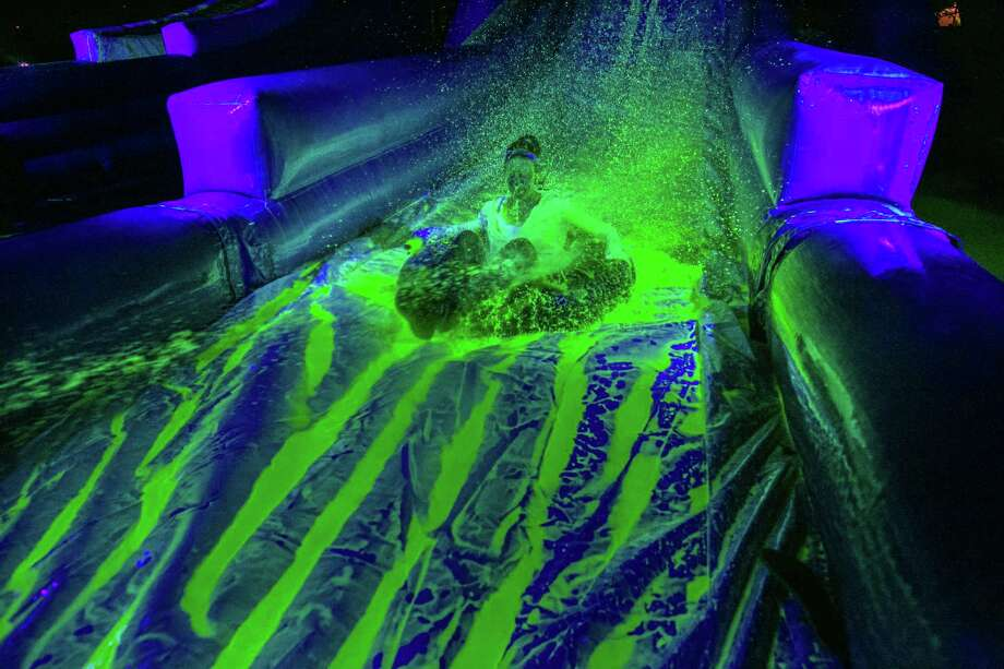 Blacklight slide party, a water-themed rave for all ages, is ...
