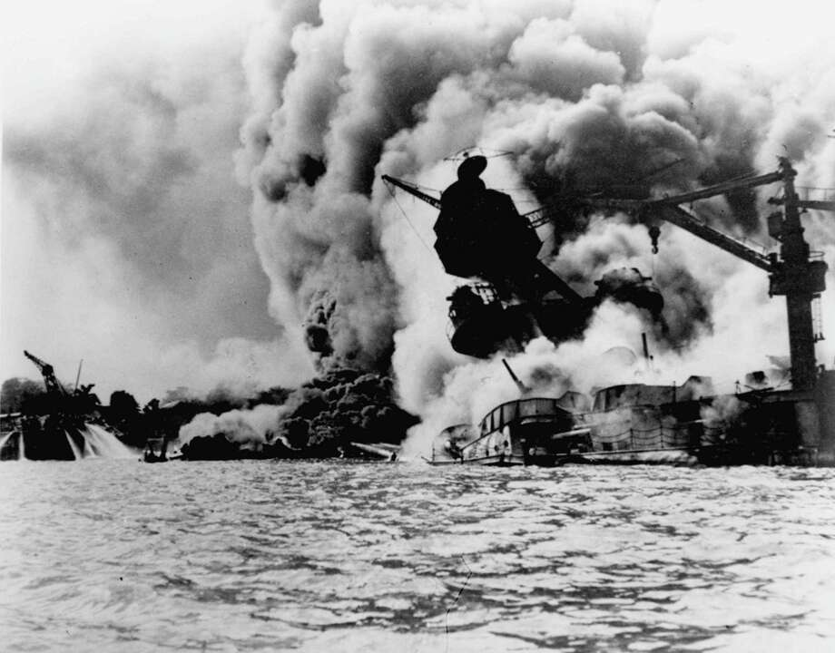 FILE-- The infamous attack on Pearl Harbor on December 7, 1941.  The USS Arizona is pictured in flames after the Japanese attack.   On Sunday, Dec. 7, 1997, the 56th anniversary of the attack that drew the United States into World War II, two Navy men who survived the battle are scheduled to have their ashes scattered on the waters above the battleship. It is an honor extended to those who survived the attack while serving on another ship, or those who served on the Arizona before the attack.(AP Photo/U.S. Navy,File) / 1997 AP