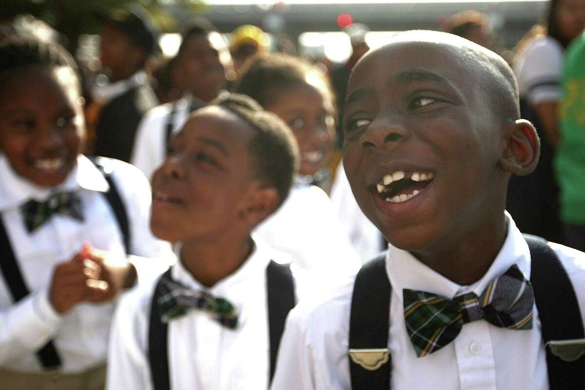 Jared Holmes laughs with his KIPP Zenith Academy classmates during a past Black Heritage Society's 36th Annual Original Martin Luther King Jr. Parade.
