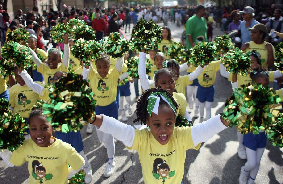 Pom-pomers with KIPP Zenith Academy cheer their way down 1600 Texas Avenue during the Black Heritage Society's 36th Annual Original Martin Luther King Jr. Parade downtown Monday, Jan. 20, 2014, in Houston. ( Johnny Hanson / Houston Chronicle )