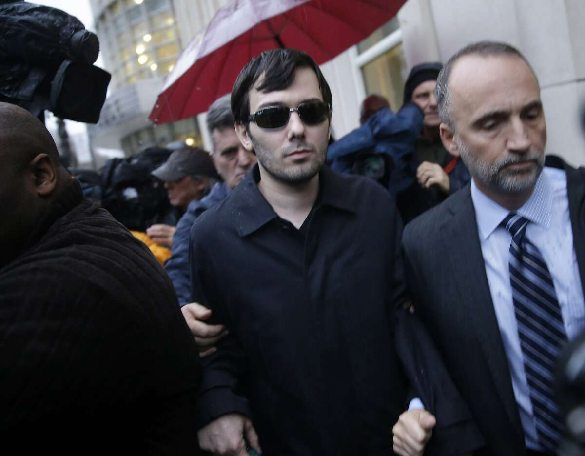 Martin Shkreli, center, leaves the courthouse after his arraignment in New York in December 2015.
