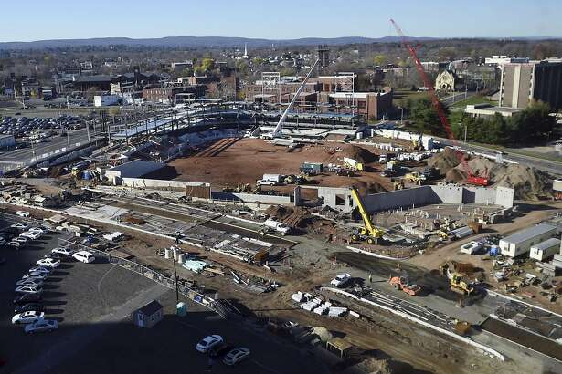In this Nov. 17, 2015 photo, construction takes place on a new baseball stadium in the north end of Hartford, Conn., to be home for the Hartford Yard Goats, the Double-A affiliate of the Colorado Rockies. The project has been plagued by cost overruns and the theft of building materials. City officials said the planned $55 million, 9,000-seat ballpark will not be ready for opening day on April 7, 2016. (Stephen Dunn/The Hartford Courant via AP)