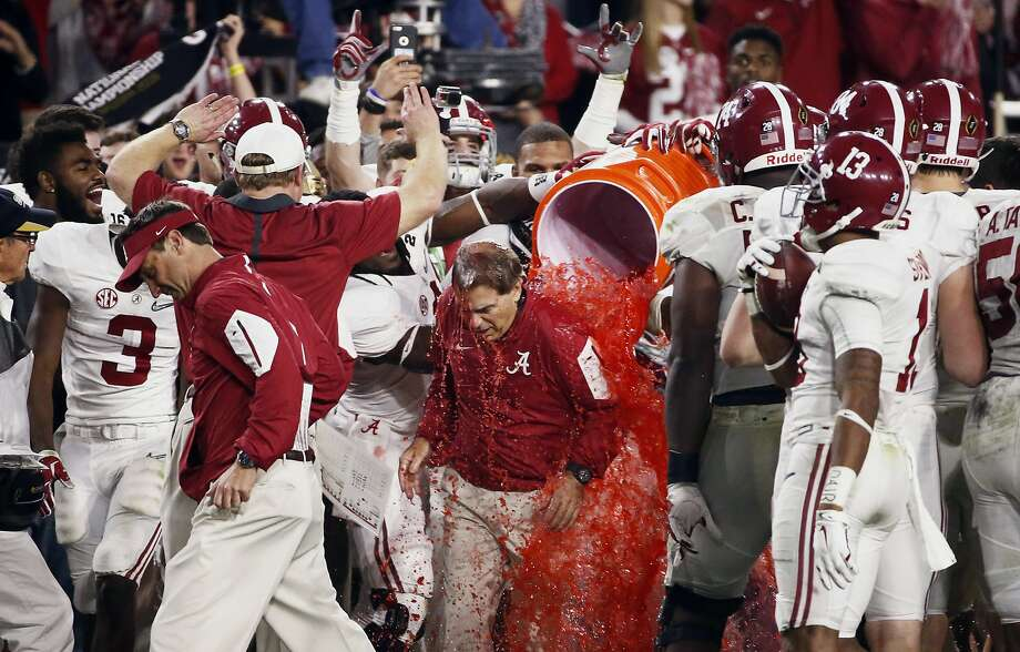 Head coach Nick Saban is awash in victory Monday night. Alabama held off Clemson in the national-title game. It was the Crimson Tide's fourth national title in the past seven seasons. Photo: Rob Schumacher, Associated Press