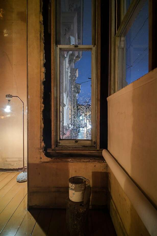 Night view through a parlor window of the David Ireland House, looking north. Photo: Takashi Fukuda, Courtesy 500 Capp St. Foundation