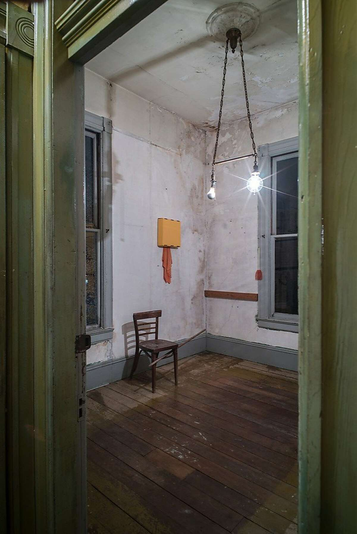After dark in the upstairs office of David Ireland's house at 500 Capp St.