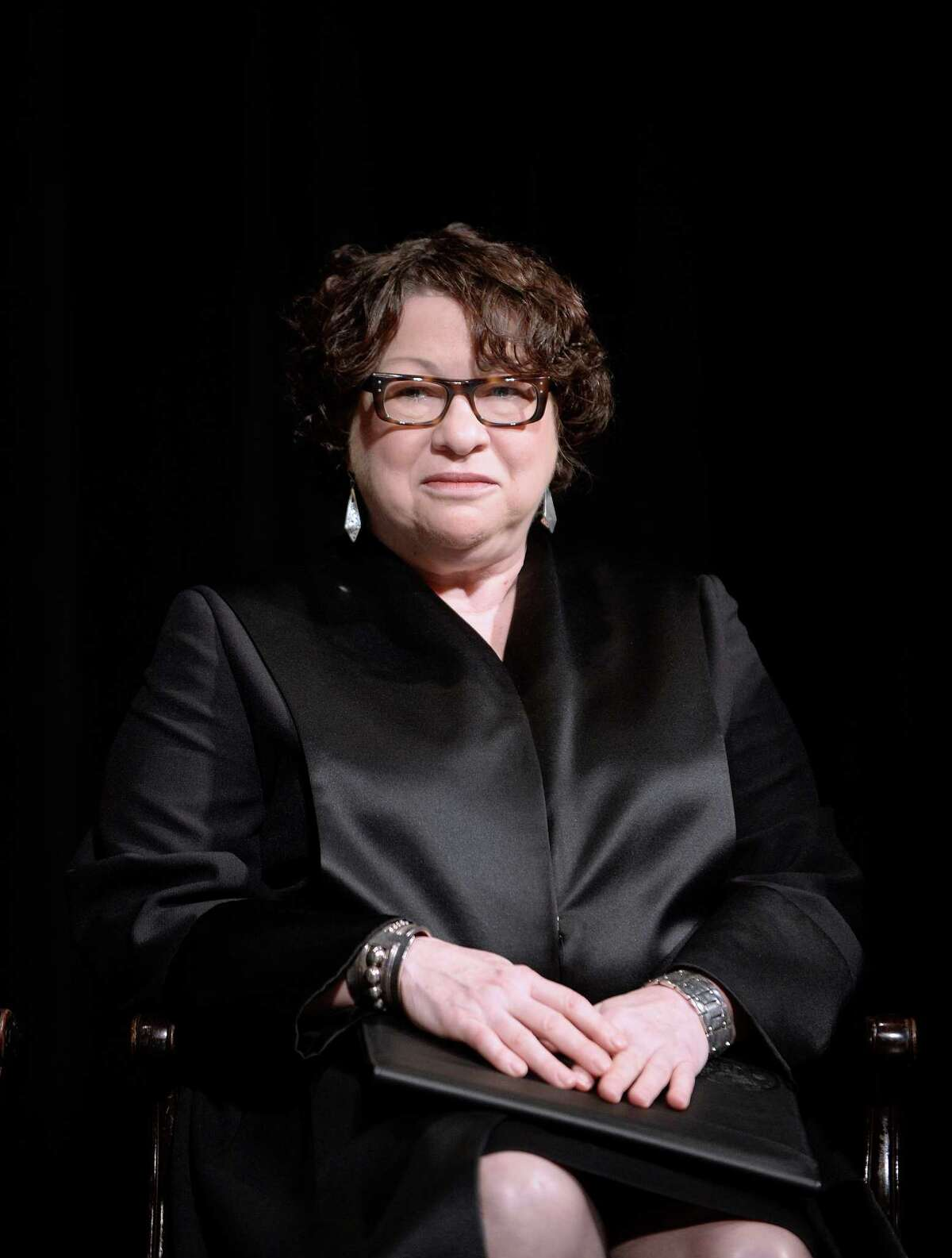 WASHINGTON, DC - JUNE 17: (AFP OUT) U.S. Supreme Court Justice Sonia Sotomayor looks on before administering the oath of office for Attorney General Loretta Lynch at the Warner Theatre on June 17, 2015 in Washington, DC. Lynch was officially sworn in by Vice President Joe Biden as the 83rd Attorney General of the United States on April 27, 2015. She is the first African-American woman to serve in the position. (Photo by Olivier Douliery - Pool/Getty Images)