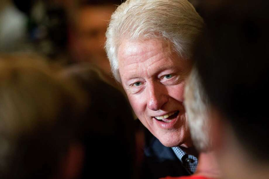 Former President Bill Clinton greets visitors after speaking during a campaign stop for his wife Democratic presidential candidate Hilary Clinton last week at the National Czech & Slovak Museum in Cedar Rapids, Iowa. Photo: AP Photo /Andrew Harnik / Associated Press / Associated Press