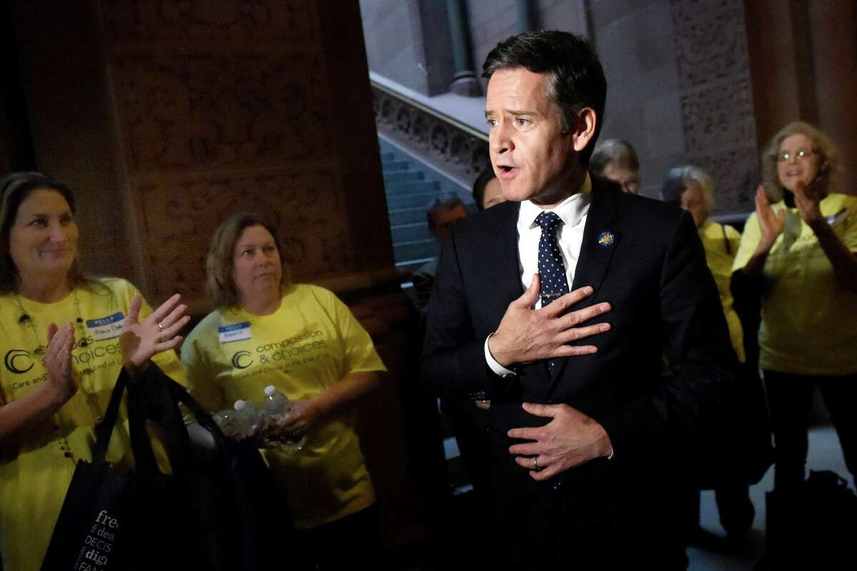 Sen. Brad Hoylman, center, discusses the death with dignity bill with Compassion and Choices advocates on Tuesday, Jan. 12, 2016, at the Capitol in Albany, N.Y. (Cindy Schultz / Times Union)