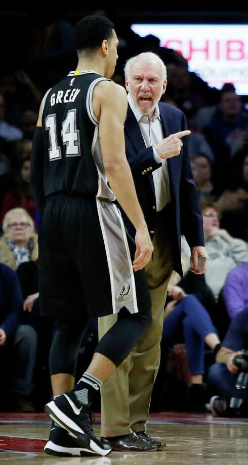 San Antonio Spurs coach Gregg Popovich, right, has some words for guard Danny Green (14) after a timeout was called during the fourth quarter of an NBA basketball game against the Detroit Pistons, Tuesday, Jan. 12, 2016, in Auburn Hills, Mich. (AP Photo/Duane Burleson) Photo: Duane Burleson, Associated Press / FR38952 AP