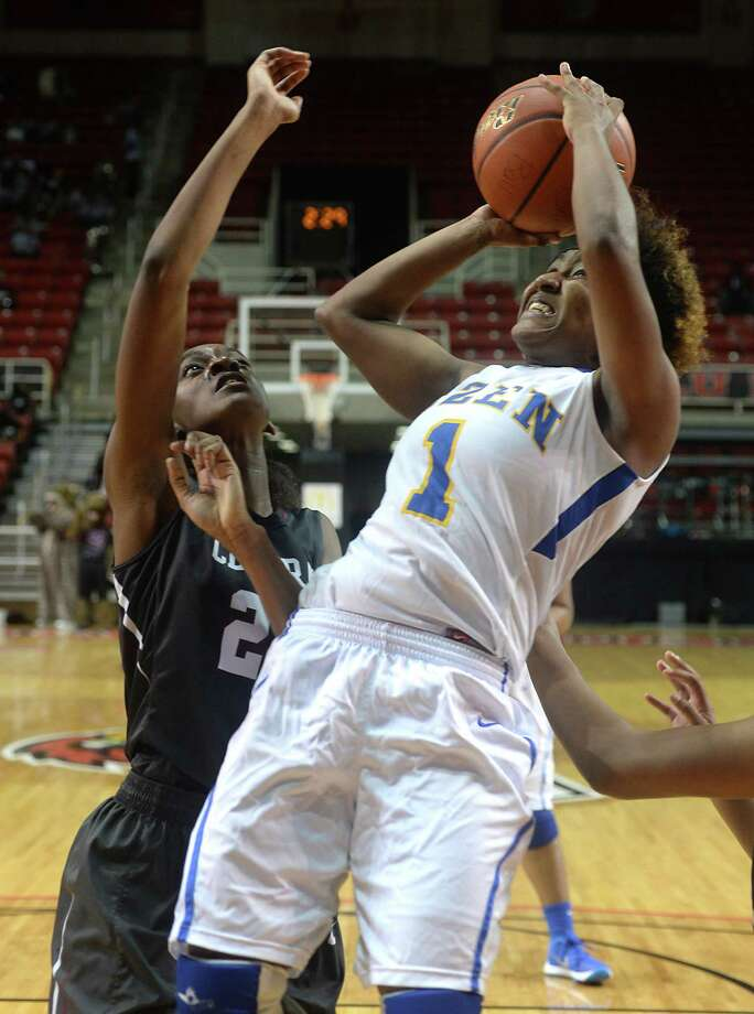 Ozen's Whitney Benard puts up her shot over the efforts of Central's Anatascia Mickens during Tuesday's double-header rivalry match-up at the Montagne Center. The Lady Jaguars and Panthers faced off first, with the boys taking the court after for the annual spirited bout between the Beaumont rivals.  Photo taken Tuesday, January 12, 2016  Kim Brent/The Enterprise Photo: Kim Brent / Beaumont Enterprise