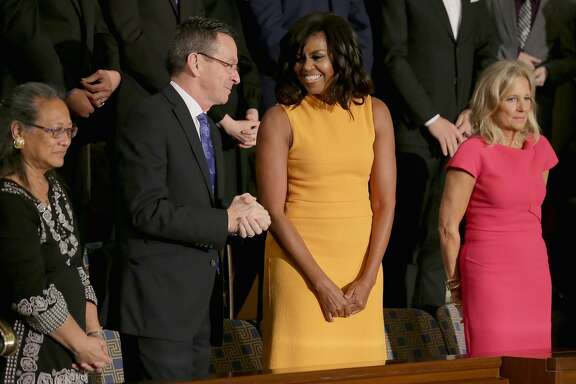 WASHINGTON, DC - JANUARY 12: (L-R) Cynthia K. Davis of Las Vegas, NV., Gov. Dannel P. Malloy of Connecticut, first lady Michelle Obama, and Wife of U.S. Vice President Joe Biden, Dr. Jill Biden arrive before US President Barack Obama delivers the State of the Union speech before members of Congress in the House chamber of the U.S. Capitol January 12, 2016 in Washington, DC. (Photo by Chip Somodevilla/Getty Images)