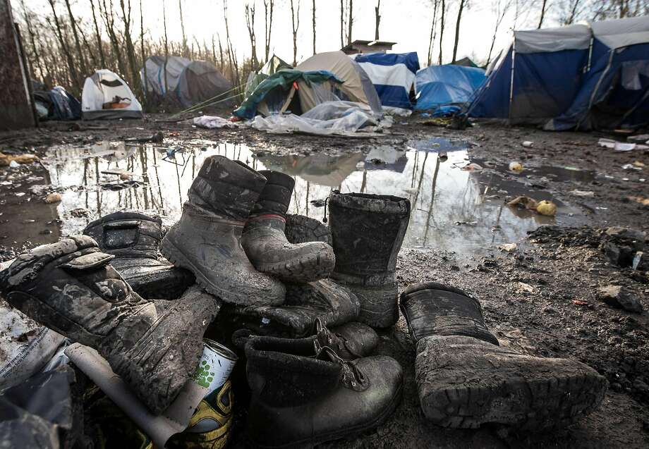 Around 3,000 refugees and migrants of Kurdish descent from Iraq and Syria live in a refugee camp in Gande-Synthe near Dunkirk, northern France, on January 12, 2016.  Photo: Philippe Huguen, AFP / Getty Images