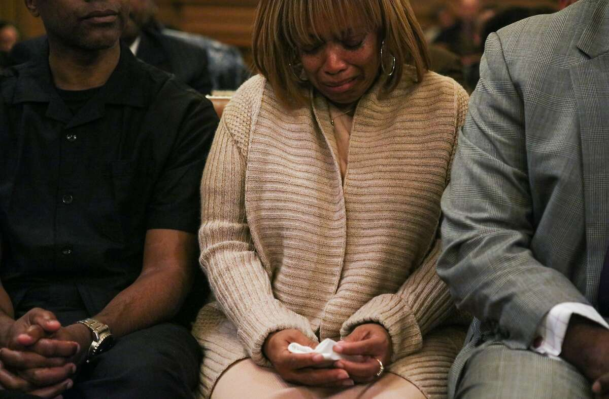 Gwen Woods (center), is overcome with emotion as Supervisor Jane Kim apologizes for the fatal shooting of her son Mario Woods, at City Hall, in San Francisco, California on Tuesday, January 12, 2016.