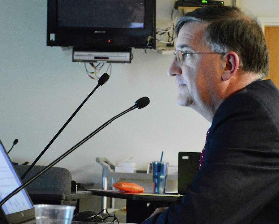 Superintendent of Schools David Title gives a presentation on his proposed $165.4 million budget for 2016-17 at Tuesday's Board of Education meeting. Photo: Jarret Liotta / Jarret Liotta / Fairfield Citizen