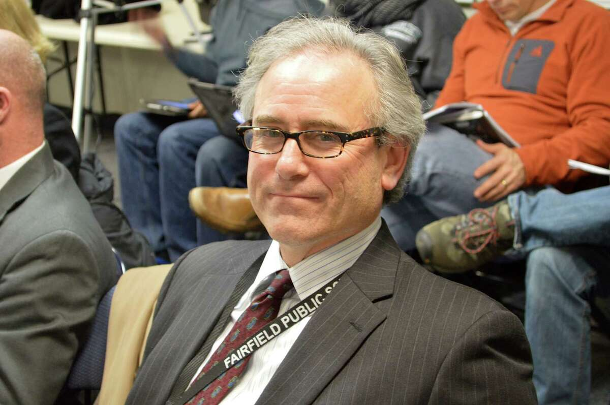 Robert Smoler, president of the Fairfield Education Association, was commended by Superintedent of Schools David Title for leading the union to embrace a new insurance plan that Title said will result in an overall reduction of $3.5 million in insurance expenses.