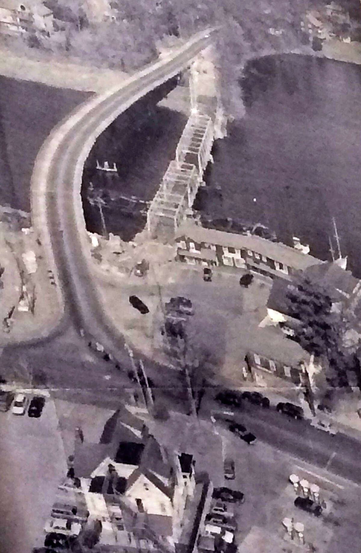 An aerial photo, displayed at the Historic District Commission meeting Tuesday, shows a temporary bridge -- to the left of the Saugatuck River swing bridge -- built while the historic span was repaired during the early 1990s.
