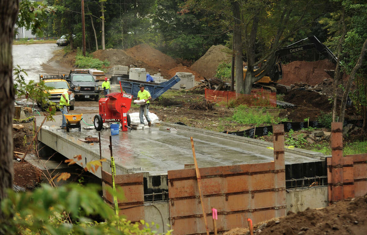 Workers construct a new bridge across the Pequonnock River above Beardsley Park in Bridgeport, Conn. on Monday, September 30, 2014 as part of new bike/walking trail being constructed from the park to the north end of Quarry Road.