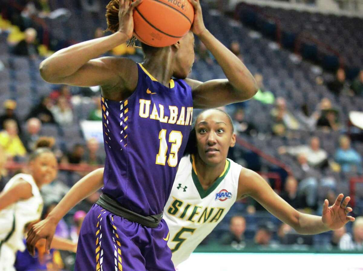 UAlbany's #13 Bose Aiyalogbe, left, is covered by Siena's #5 Jackie Benitez during Saturday's game at the Times Union Center Dec. 12, 2015 in Albany, NY. (John Carl D'Annibale / Times Union)