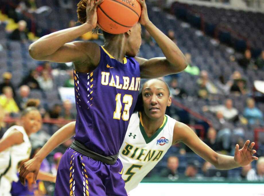 UAlbany's #13 Bose Aiyalogbe, left, is covered by Siena's #5 Jackie Benitez during Saturday's game at the Times Union Center Dec. 12, 2015 in Albany, NY.   (John Carl D'Annibale / Times Union) Photo: John Carl D'Annibale / 10034571A
