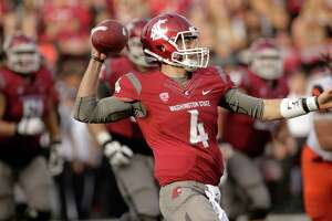FILE - In this Oct. 17, 2015, file photo, Washington State quarterback Luke Falk (4) throws a pass during the second half of an NCAA college football game against Oregon State, in Pullman, Wash. Falk leads the country in passing yardage per game (387.8), and will be directing Washington State's version of the Air Raid against Miami in the Sun Bowl on Dec. 26. (AP Photo/Young Kwak, File)