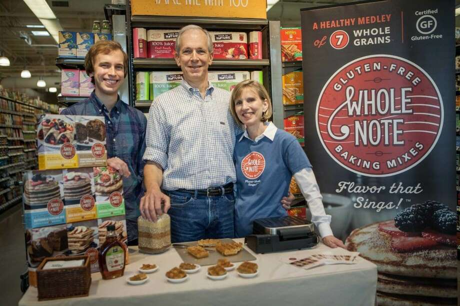 Paul Morris is the founder of Whole Note Baking Co. He poses with wife Bonnie, and son Stephen.
