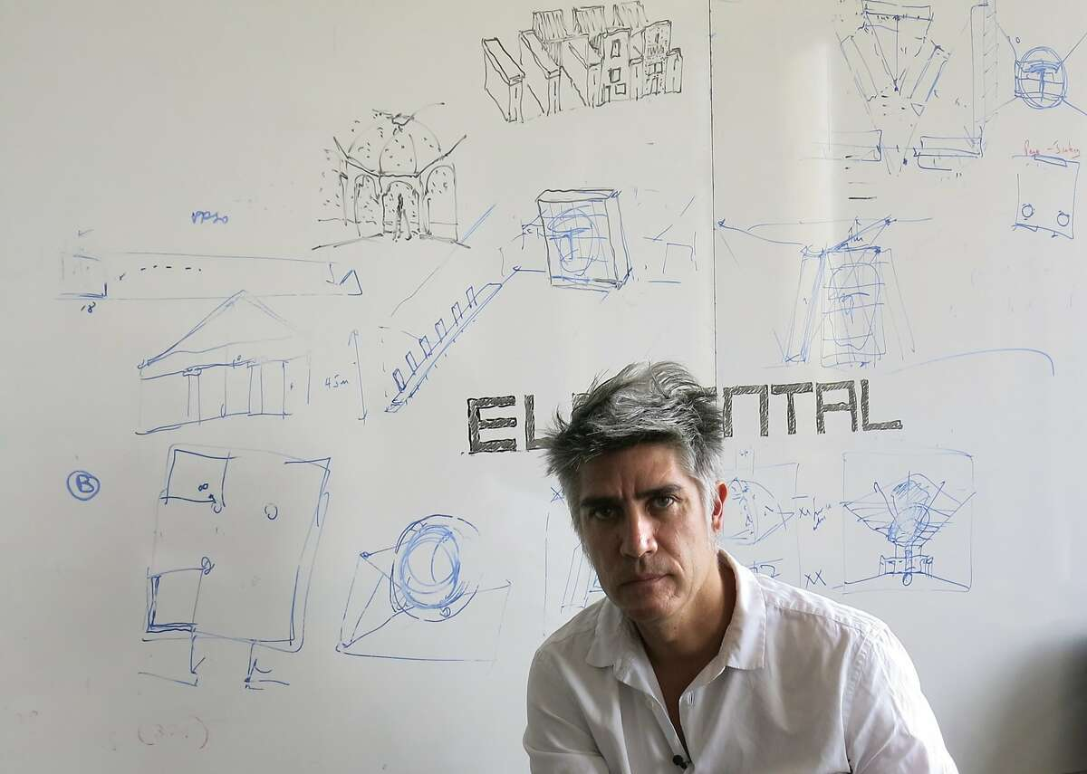 Chilean architect Alejandro Aravena poses for a photo at his studio in Santiago, Chile, Tuesday, Jan. 12, 2016. Aravena has been named the 2016 recipient of the Pritzker Prize. (AP Photo/Eva Vergara)