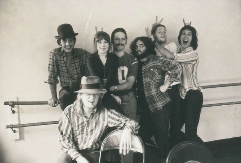 """Garry Goodrow, Alice Peyton, Christopher Guest, John Belushi, Peter Elbling, Chevy Chase and Tony Hendra (front) in """"Drunk Stoned Brilliant Dead: The Story of the National Lampoon."""" Photo: Contributed Photo / Connecticut Post Contributed"""