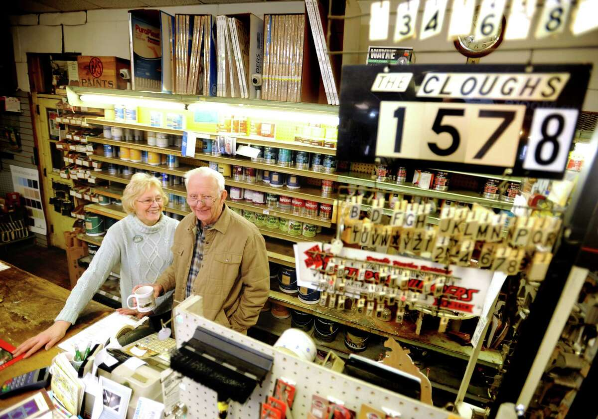 Evelyn and Ron Clough Sr. stand behind the counter at Clough's Hardware in Stratford, which was started by Ron Clough's father in 1933. The store on Main Street, across from Paradise Green is closing after more than eight decades in business.