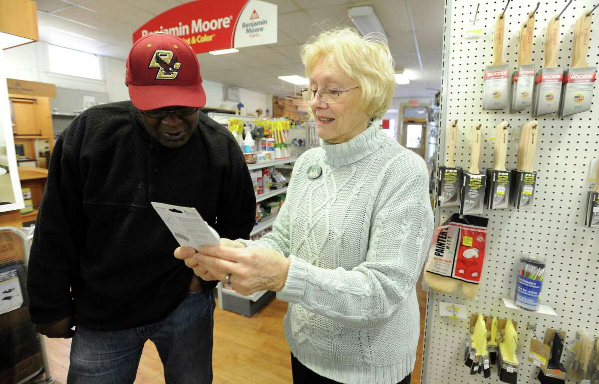 Evelyn Clough helps customer Steve Jones at Clough's Hardware in Stratford Tuesday, Dec. 8, 2015. Jones said he is saddened to learn that the store on Main Street, across from Paradise Green is closing after more than eight decades in business. Despite moving from Stratford to Shelton, Jones continued to visit Clough's whenever he needed something for his home.