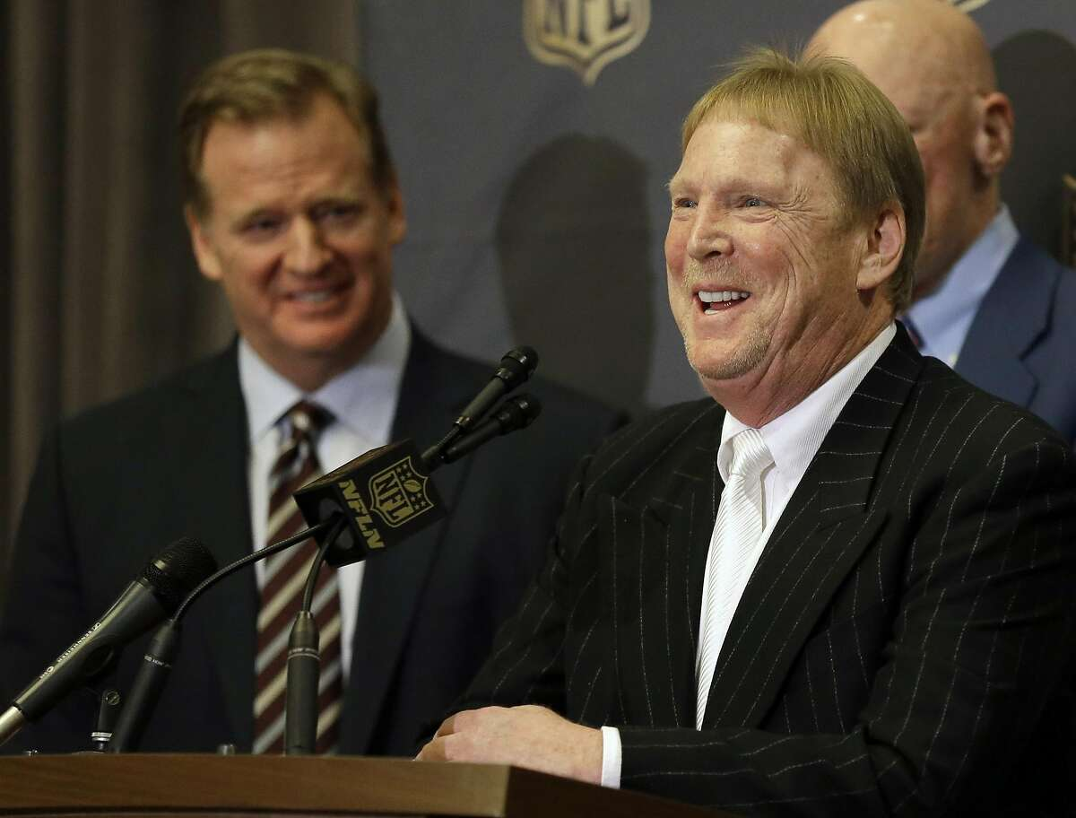 NFL Commissioner Roger Goodell, left, laughs as Oakland Raiders owner Mark Davis talks to the media after an NFL owners meeting Tuesday, Jan. 12, 2016, in Houston.
